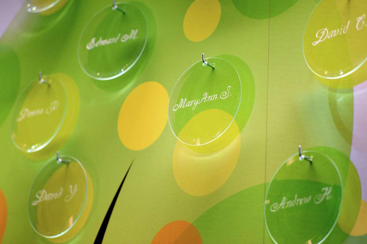 Names of organ donors are etched on glass ornaments as part of the Tree of Life in the lobby of the Albany Medical Center on Thursday, June 5, 2014, in Albany, N.Y. The Tree of Life is dedicated to 24 individuals who were organ donors in 2013 and contains glass ornaments etched with their names. (Paul Buckowski / Times Union)