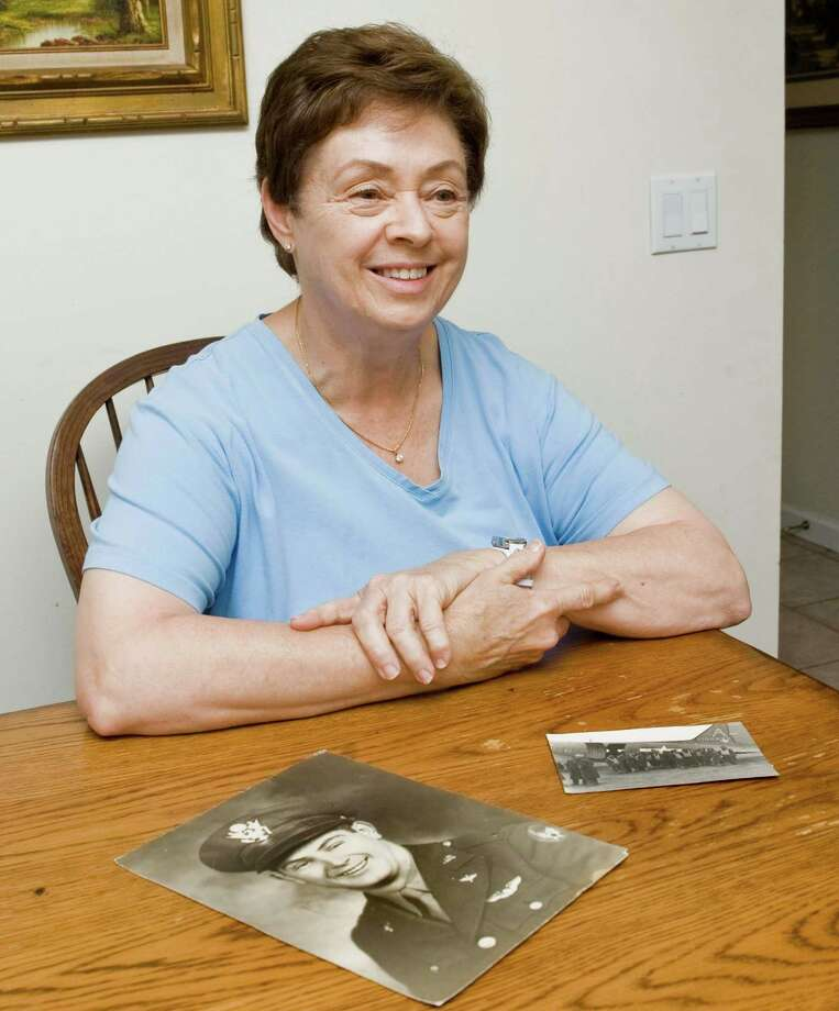 Donna Vanech, daughter of the late D-Day veteran and Stamford native Constantine Vanech, with WWII photographs of her father in her Danbury home. Thursday, June 5, 2014 Photo: Scott Mullin / The News-Times Freelance