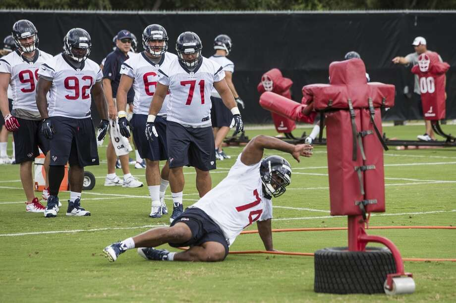 Defensive lineman Julius Warmsley (74) runs through a drill. Photo: Brett Coomer, Houston Chronicle