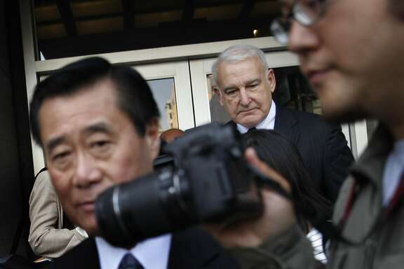 Suspended California state Sen. Leland Yee (left) and attorney James Lassart (right)  leave the Phillip Burton Federal Building and United States Courthouse after Yee's arraignment on Tuesday, April 8, 2014,  in San Francisco, Calif.