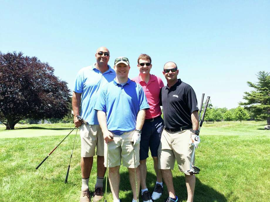 "From left: Joe Massoud, Dave Swanson, Tim Chiodo and Alan Offenberg. Swanson fired a hole-in-one on the second hole as the Staples Grid Iron Club raised $30,000 at the Sal ""Peppers"" Romano 8th Annual Golf Outing conducted at Longshore on June 2nd. Photo: Contributed Photo / Westport News Contributed"