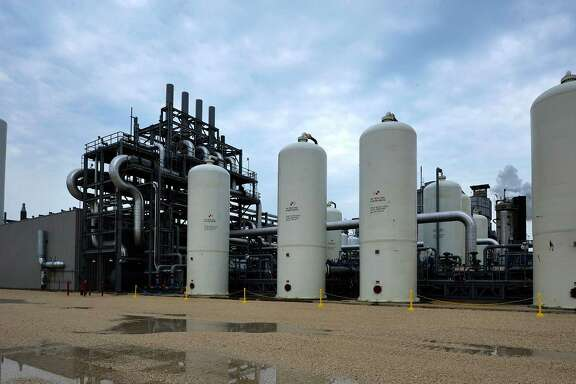 In a demonstration project, this Air Products facility captures CO2 emitted at a refinery in Port Arthur and sends it to help push oil out of an aging field south of Houston.