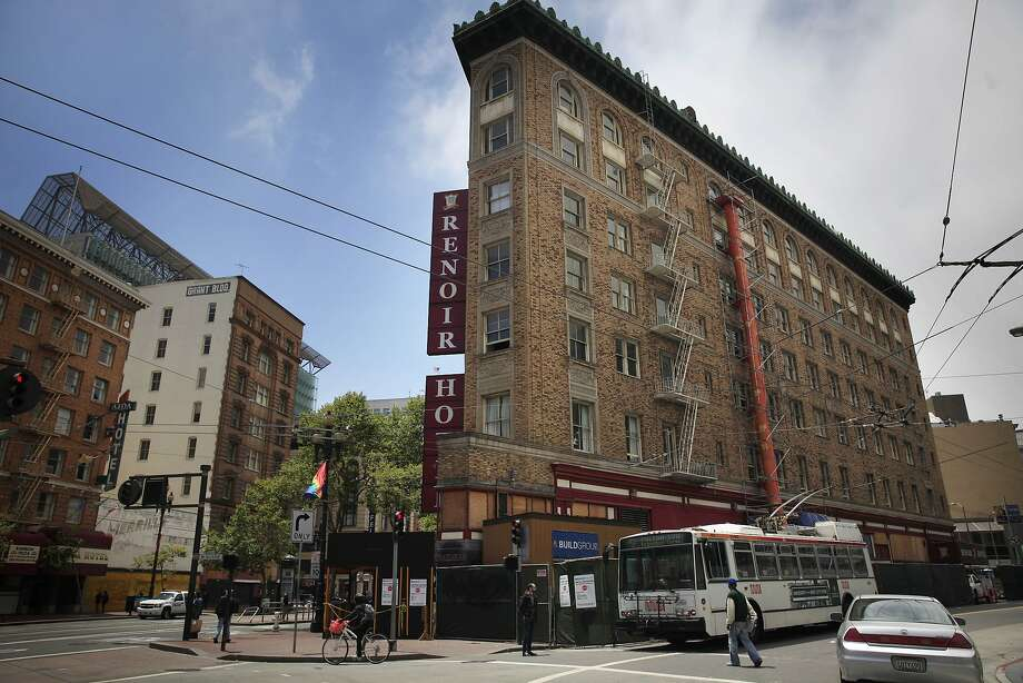 The Aida (left) and Renoir Hotel (right) are about to get a new neighbor with the Grant Building's remake into a Yotel (center). Photo: Lea Suzuki, The Chronicle