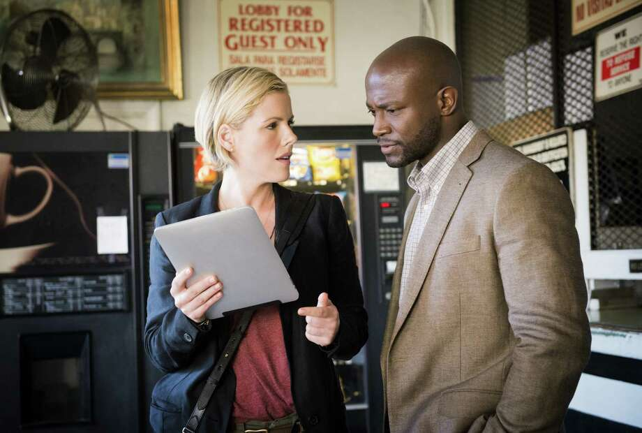 Kathleen Robertson and Taye Diggs play homicide cops that don't fit the usual cliches in 'Murder in the First' on TNT. Photo: TNT / San Antonio Express-News
