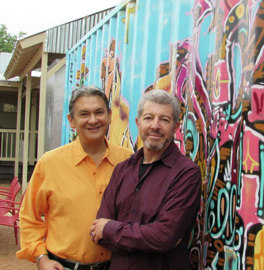 Johnny Moreno Jr, (left) and Oscar Montiel, who own the Grayson Street Eatery, stand in front of a mural painted by San Antonio artist Davy Anaya on the restaurant's patio. The owners showcase local artists periodically. Photo: Burt Henry, San Antonio Express-News