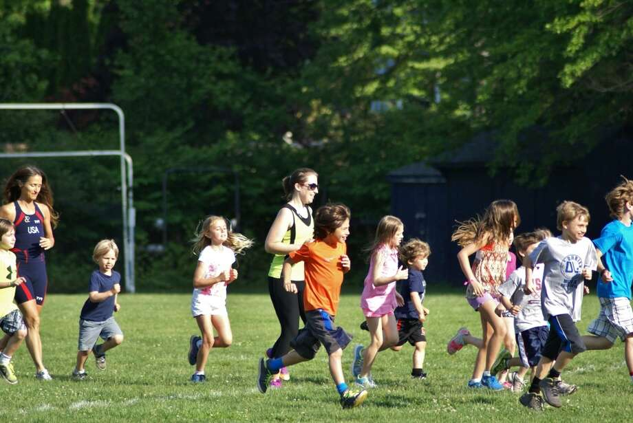 Old Greenwich School students participate Tuesday in the fun run fundraiser for the nonprofit Mary's Meals.