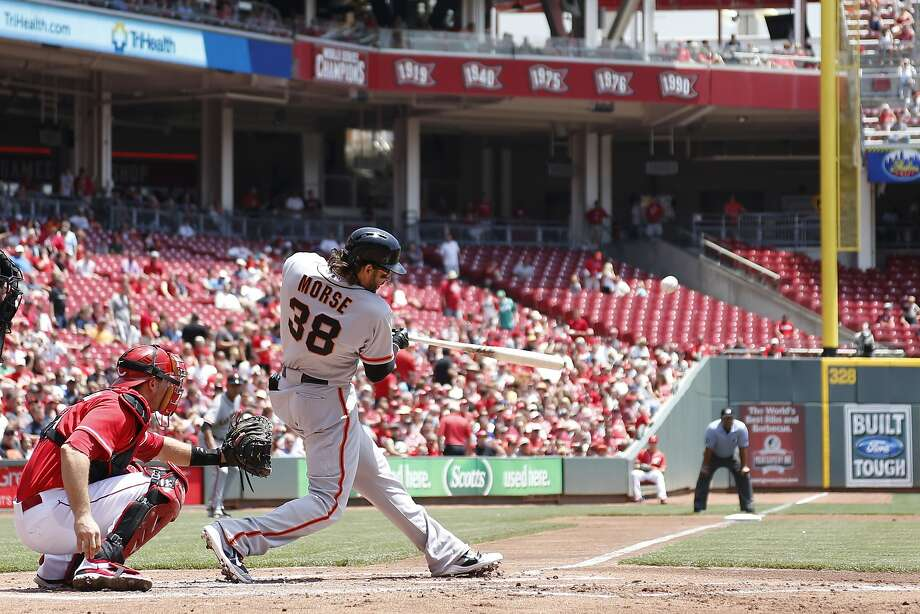 Michael Morse swats his 13th homer of the season in the second inning off Cincinnati's Mike Leake to give the Giants a 2-1 lead. Photo: Joe Robbins, Getty Images