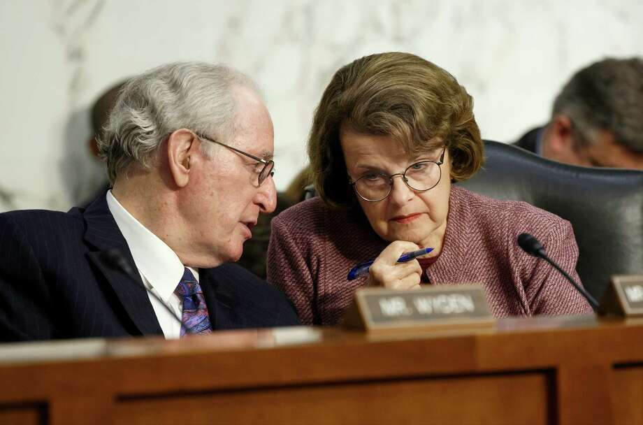 Senate Intelligence Committee Chair Sen. Dianne Feinstein, D-Calif. confers with Sen. Jay Rockefeller, D-W.Va., on Capitol Hill in Washington, Thursday, June 5, 2014, as the committee hears from intelligence officials about reforming the practice of bulk collection of telephone records by the National Security Agency and other government agencies.  (AP Photo/J. Scott Applewhite) Photo: J. Scott Applewhite, STF / AP