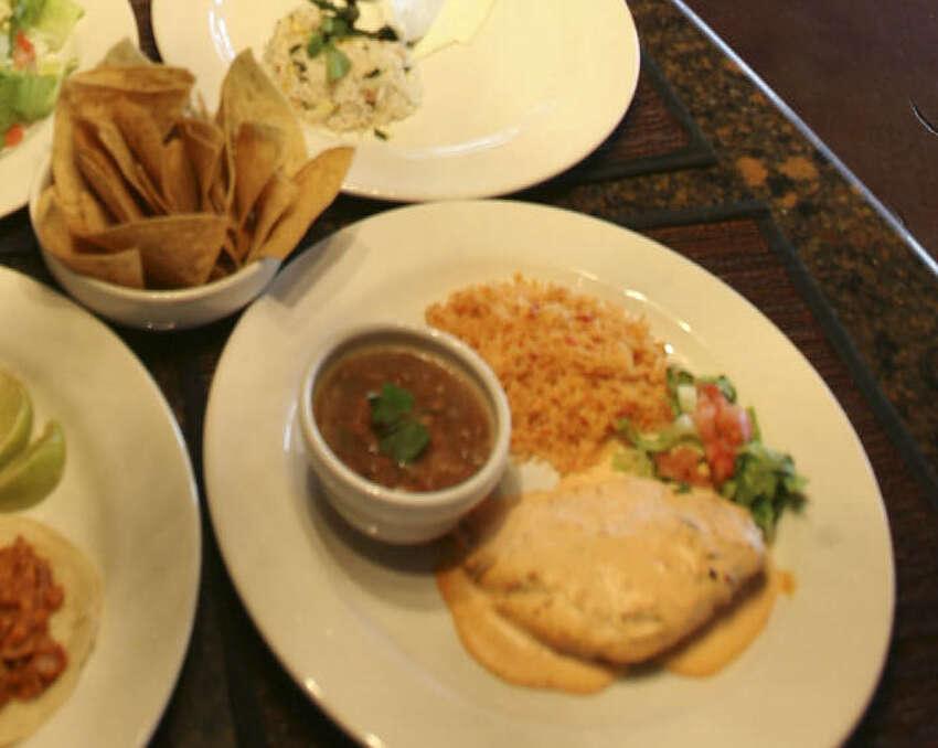 From bottom left to right: Tacos al pastor, Ensalada tres Marias, chile relleno with crema poblano and pechuga de pollo al chipotle, from Aldaco's Stone Oak Parkway.