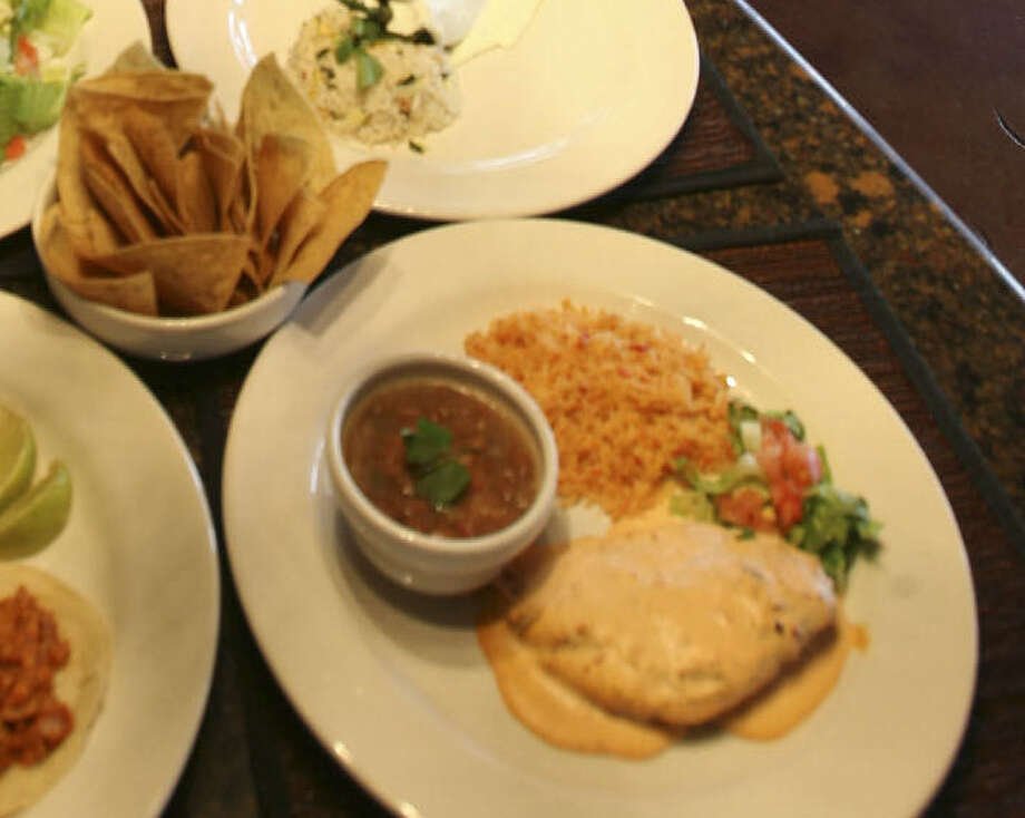From bottom left to right: Tacos al pastor, Ensalada tres Marias, chile relleno with crema poblano and pechuga de pollo al chipotle, from Aldaco's Stone Oak Parkway. Photo: DELCIA LOPEZ, Delcia Lopez/Express News / delopez@express-news.net