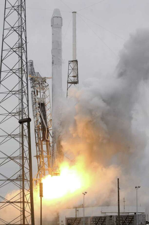 Space X's Falcon 9 rocket lifts off from Cape Canaveral, Florida on April 18, 2014 carrying its Dragon CRS3 spacecraft on a resupply mission to the International Space Station (ISS).  Private US firm SpaceX launched its unmanned Dragon capsule to the International Space Station on April 18, 2014, its third trip carrying supplies and equipment to the orbiting lab.  After three earlier delays, the Falcon 9 rocket and its Dragon capsule finally blasted off as planned at 3:25 pm (1925 GMT) from Cape Canaveral in Florida.                AFP PHOTO / Bruce WeaverBRUCE WEAVER/AFP/Getty Images Photo: BRUCE WEAVER, Stringer / AFP