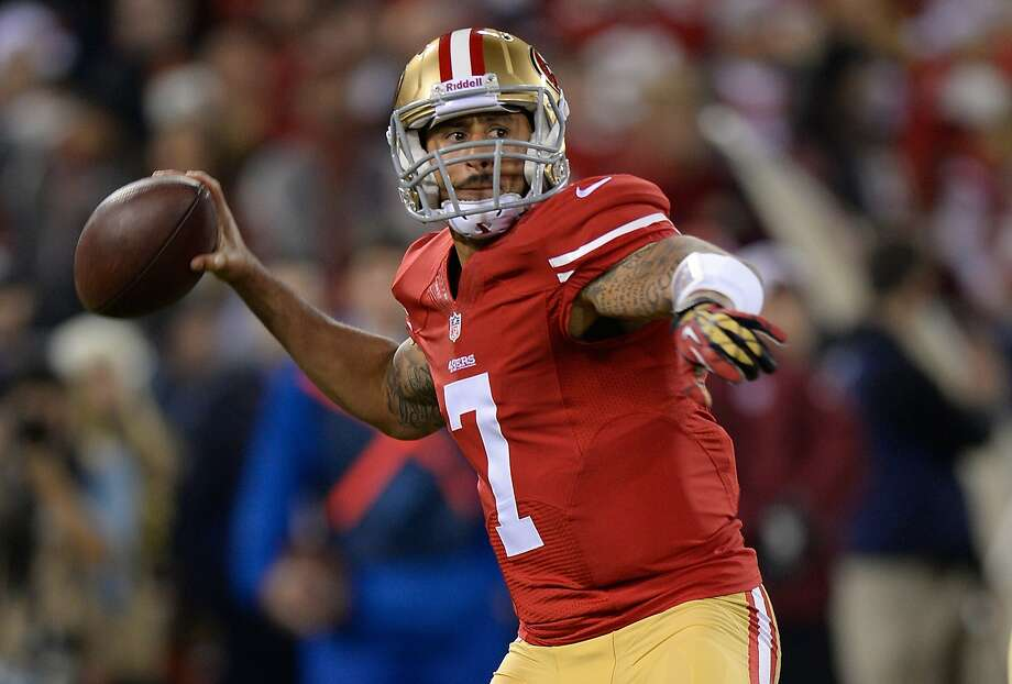 FILE - JUNE 4: According to reports June 4, 2014, quarterback Colin Kaepernick signed a six-year $110 million deal, including $61 million guaranteed, with the San Fransisco 49ers. SAN FRANCISCO, CA - DECEMBER 23:  Colin Kaepernick #7 of the San Francisco 49ers drops back to pass against the Atlanta Falcons at Candlestick Park on December 23, 2013 in San Francisco, California.  (Photo by Thearon W. Henderson/Getty Images) Photo: Thearon W. Henderson, Getty Images