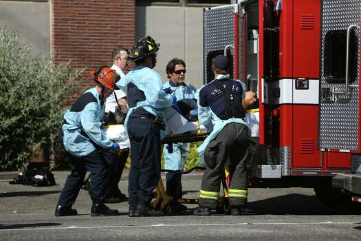 Seattle firefighters remove a victim from the scene of shootings at Seattle Pacific University on Thursday, June 5, 2014 in Seattle. Photo: Joshua Trujillo, Seattlepi.com / seattlepi.com