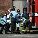 Seattle firefighters remove a victim from the scene of shootings at Seattle Pacific University on Thursday, June 5, 2014 in Seattle.