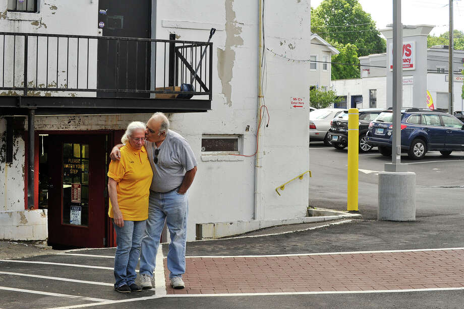 Edward and Lidia Caceres, owners of Mr. C's Fix Up Shop, are worried about staying in business due to a loss of customers from the nearly year-long construction of the CVS outside their doors making it difficult for customers to reach their business. Photo: Jason Rearick / Stamford Advocate