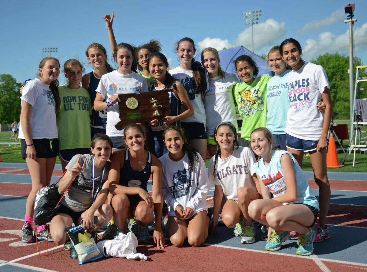 The Staples girls track and field team poses after winning the CIAC Class LL Connecticut Outdoor Track & Field State Championship at Danbury High School in Danbury, Conn. Thursday, June 5, 2014.