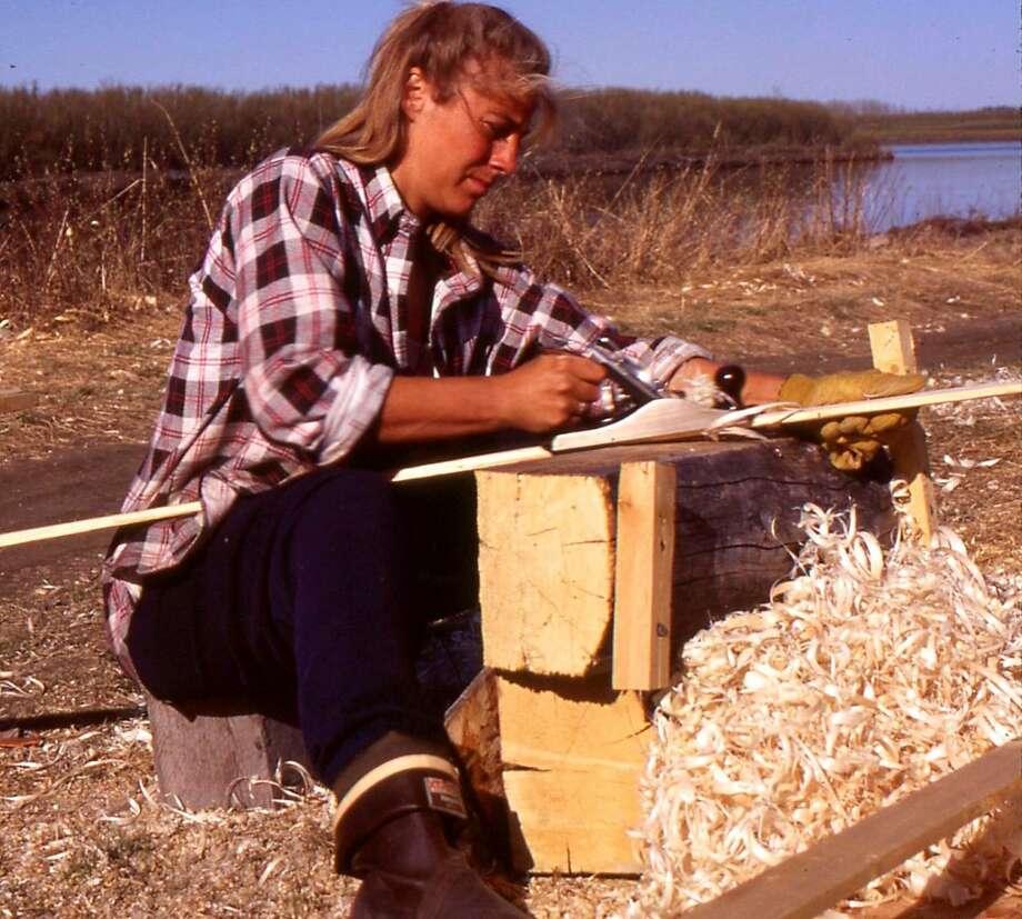 Reinette Senum hand-planes a canoe. Her one-woman show portrays her daring journey. Photo: Reinette Senum