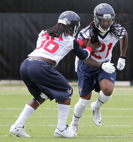 Texans free safety Kendrick Lewis, right, is back in the area of NRG Stadium under vastly difference circumstances than after Hurricane Katrina in 2005. Photo: James Nielsen, Staff / © 2014  Houston Chronicle