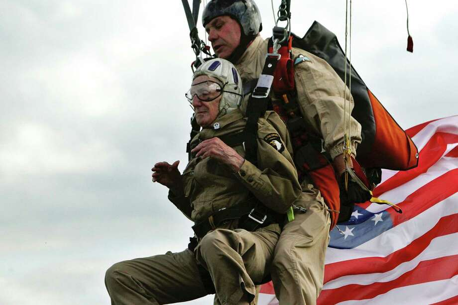 U.S WW II veteran Jim Martin, 93, of the 101st Airborne, left, is one of many veterans preparing to mark the 70th anniversary in Normandy, France. Photo: Thibault Camus, STR / AP