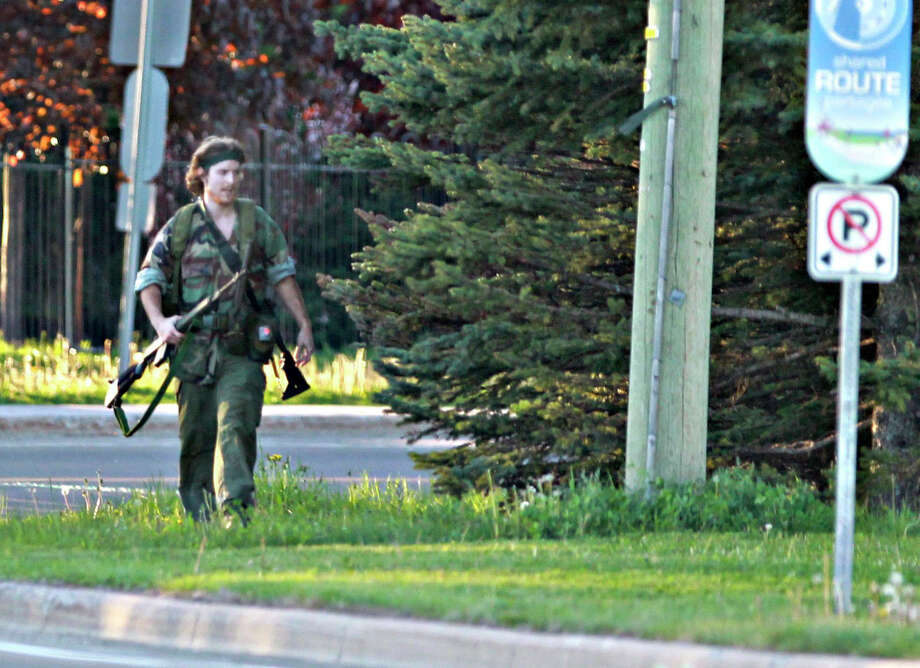 An armed man that police have identified as Justin Bourque is being hunted in Moncton, New Brunswick. He is suspected of shooting down three Royal Canadian Mounted Police officers. Photo: Viktor Pivovarov, SUB / Moncton Times & Transcript via C
