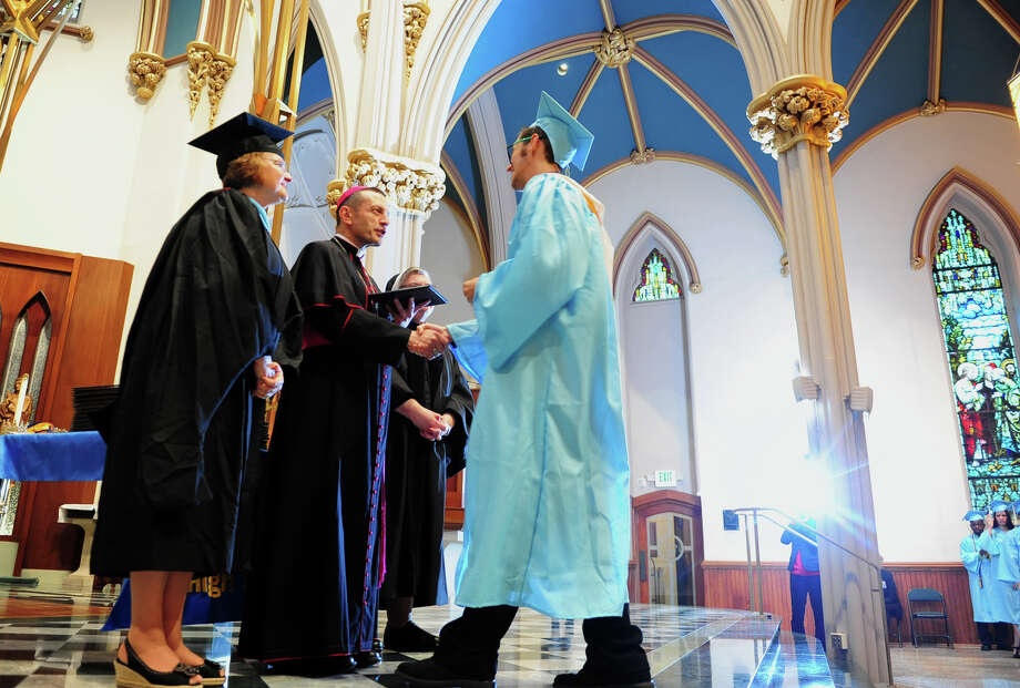 Graduate Spencer Martin receives his diploma from Bishop Frank Caggiano, during Kolbe Cathedral's Class of 2014 Commencement Exercises at St. Augustine Cathedral in Bridgeport, Conn. on Thursday June 5, 2014. Photo: Christian Abraham / Connecticut Post