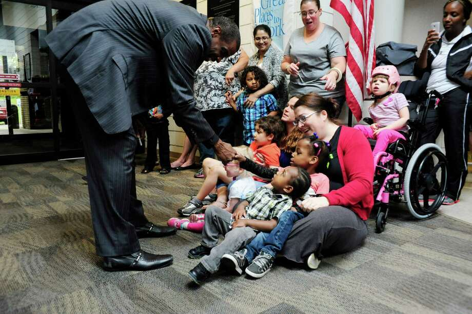 "Former pitcher for the New York Mets and Yankees, Dwight ""Doc"" Gooden, shakes hands with children at the  Center for Disability Services on Thursday, June 5, 2014, in Albany, N.Y.   (Paul Buckowski / Times Union) Photo: Paul Buckowski / 00027183A"