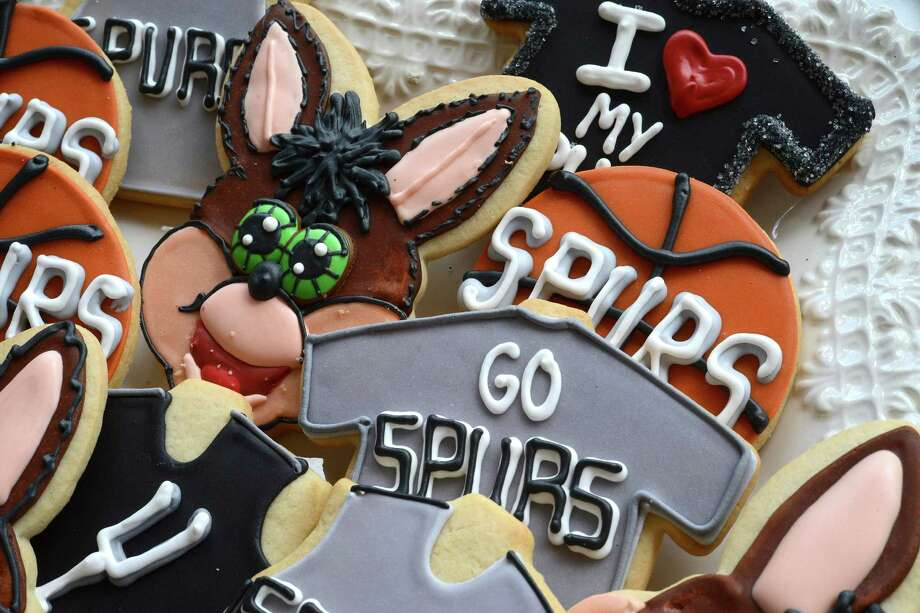 Lily's Cookies,  www.lilyscookies.com,  2716 McCullough Ave., 210-832-0886 Lily's Cookies has an assortment of Spurs-related sweets on Thursday, June 5, 2014. The hometown San Antonio Spurs are playing the Miami Heat for the NBA basketball championship this month. Photo: Billy Calzada, San Antonio Express-News / San Antonio Express-News