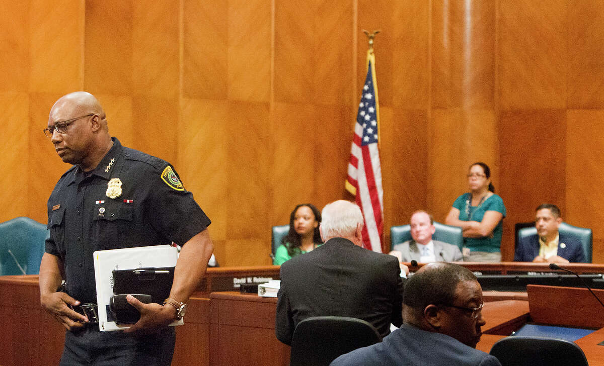 Police Chief Charles McClelland leaves after speaking to City Council at City Hall regarding the police department's budget, Thursday, June 5, 2014, in Houston. (Cody Duty / Houston Chronicle)