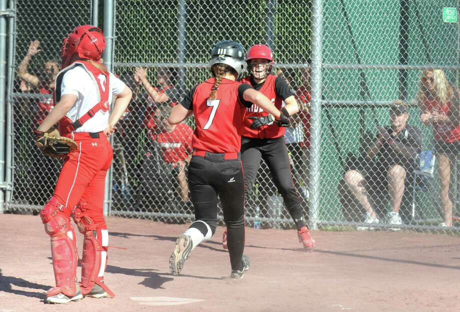 Mechanicville celebrates after scoring two runs during their girl's high school softball Class B state quarterfinal against Saranacon Thursday June 5, 2014 in Malta, N.Y. (Michael P. Farrell/Times Union) Photo: Michael P. Farrell / 00027213A