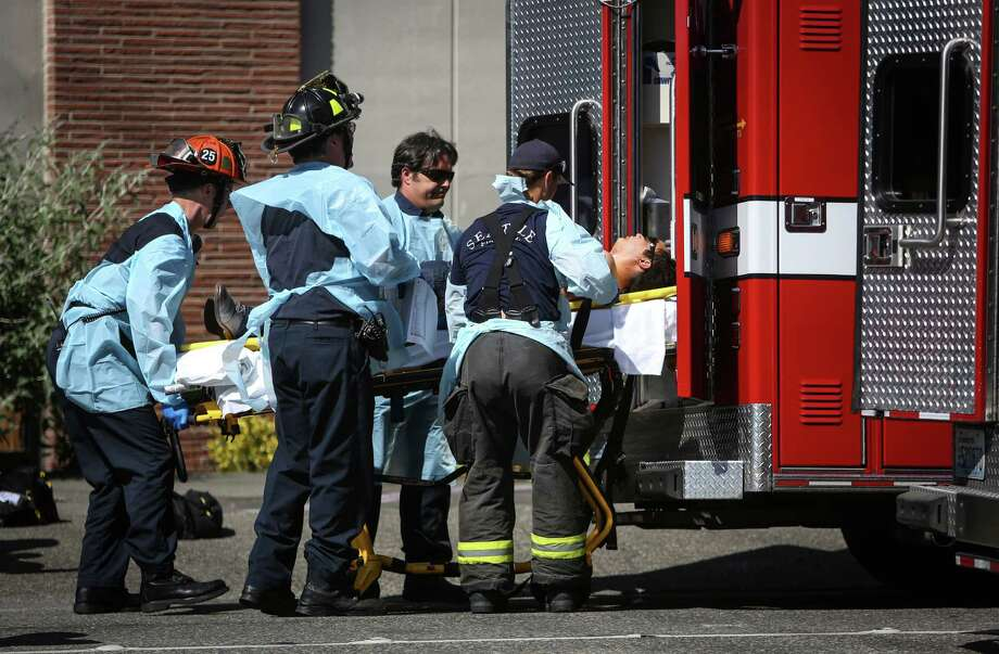 Medics load a victim in an ambulance after a shooting at Seattle Pacific University on Thursday, June 5, 2014. A man that shot students was disarmed by others at the scene. Photo: JOSHUA TRUJILLO, SEATTLEPI.COM / SEATTLEPI.COM