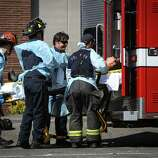 Medics load a victim in an ambulance after a shooting at Seattle Pacific University on Thursday, June 5, 2014. A man that shot students was disarmed by others at the scene.