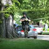 Officers mark an area near the crime scene after a shooting at Seattle Pacific University on Thursday, June 5, 2014.