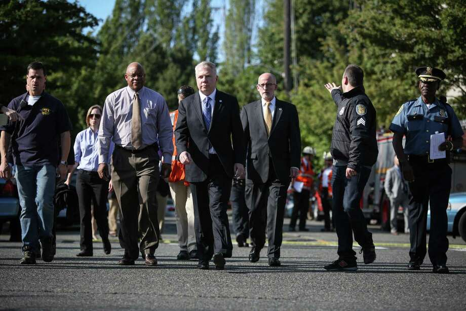 City of Seattle leaders, including Mayor Ed Murray, center, prepare to address the public after a shooting at Seattle Pacific University on Thursday, June 5, 2014. Photo: JOSHUA TRUJILLO, SEATTLEPI.COM / SEATTLEPI.COM