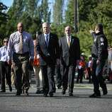 City of Seattle leaders, including Mayor Ed Murray, center, prepare to address the public after a shooting at Seattle Pacific University on Thursday, June 5, 2014.