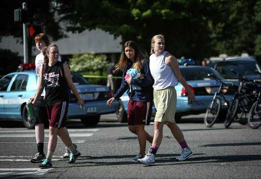 Students evacuate from the gym after a shooting at Seattle Pacific University on Thursday, June 5, 2014. Photo: JOSHUA TRUJILLO, SEATTLEPI.COM / SEATTLEPI.COM