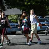 Students evacuate from the gym after a shooting at Seattle Pacific University on Thursday, June 5, 2014.