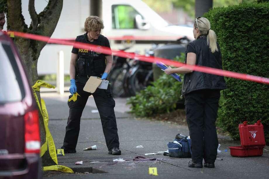 Crime scene investigators work the scene after a shooting at Seattle Pacific University on Thursday, June 5, 2014. Photo: JOSHUA TRUJILLO, SEATTLEPI.COM / SEATTLEPI.COM