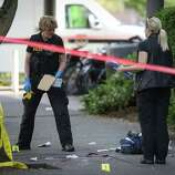 Crime scene investigators work the scene after a shooting at Seattle Pacific University on Thursday, June 5, 2014.