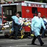 Medics wheel away a person shot at Seattle Pacific University on Thursday, June 5, 2014. A man that shot students was disarmed by others at the scene.