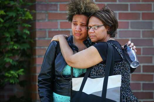 "Gloris Jones, 20, is embraced by her mother Mary Jones after Gloris' friend was shot at Seattle Pacific University on Thursday, June 5, 2014. Her mom stopped by to help her daughter as school wraps up for the semester. ""When you send your children away to college there is a reasonable expectation that they'd be safe. This makes me question,"" Mary Jones said after a man that shot students was disarmed by others at the scene. Photo: JOSHUA TRUJILLO, SEATTLEPI.COM / SEATTLEPI.COM"