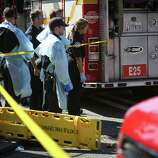 Medics take cover behind a fire truck after a shooting at Seattle Pacific University on Thursday, June 5, 2014. A man that shot students was disarmed by others at the scene.