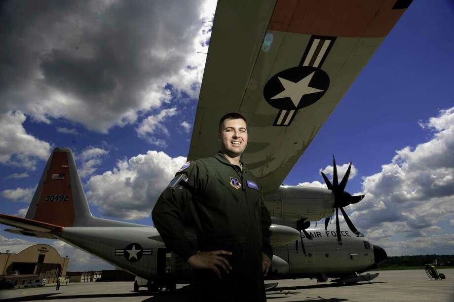 Major Erik Srokowski, a pilot with the New York Air National Guard's 109th Airlift Wing, stands outside a  LC-130 on Thursday, June 5, 2014, in Scotia, N.Y.  Srokowski has been with the 109th Airlift Wing for 24 years and started off in maintenance before training to become a pilot.  He flew this season.s first period trip up to Greenland where members of the 109th support  National Science Foundation research.  The first period trip is carried out to open up Summit camp and to make supply runs bringing in scientists, food and fuel. (Paul Buckowski / Times Union) Photo: Paul Buckowski / 00027216A