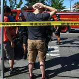 Seattle Police search students after a shooting at Seattle Pacific University on Thursday, June 5, 2014. A man that shot students was disarmed by others at the scene.