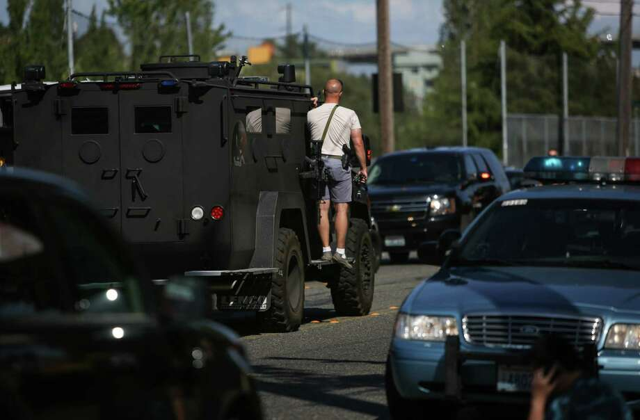 SWAT officers take their position after a shooting at Seattle Pacific University on Thursday, June 5, 2014. A man that shot students was disarmed by others at the scene. Photo: JOSHUA TRUJILLO, SEATTLEPI.COM / SEATTLEPI.COM