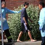 Jon Meis, who is credited with stopping the shooter by pepper spraying  him and tackling him, is taken from the scene by medics after a shooting  at Seattle Pacific University on Thursday, June 5, 2014.