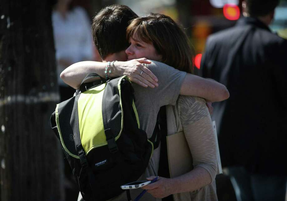 People embrace after a shooting at Seattle Pacific University on Thursday, June 5, 2014. A man that shot students was disarmed by others at the scene. Photo: JOSHUA TRUJILLO, SEATTLEPI.COM / SEATTLEPI.COM