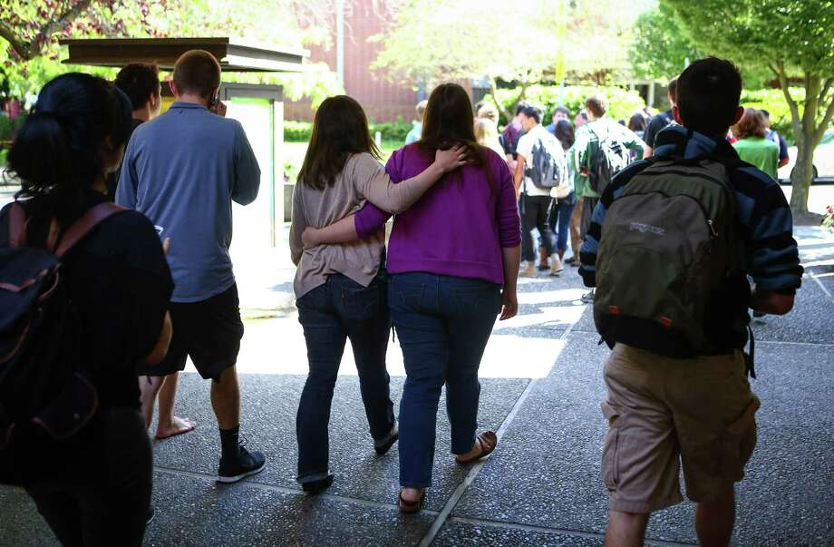 Students are evacuated after a shooting at Seattle Pacific University on Thursday, June 5, 2014. A man that shot students was disarmed by others at the scene. Photo: JOSHUA TRUJILLO, SEATTLEPI.COM / SEATTLEPI.COM