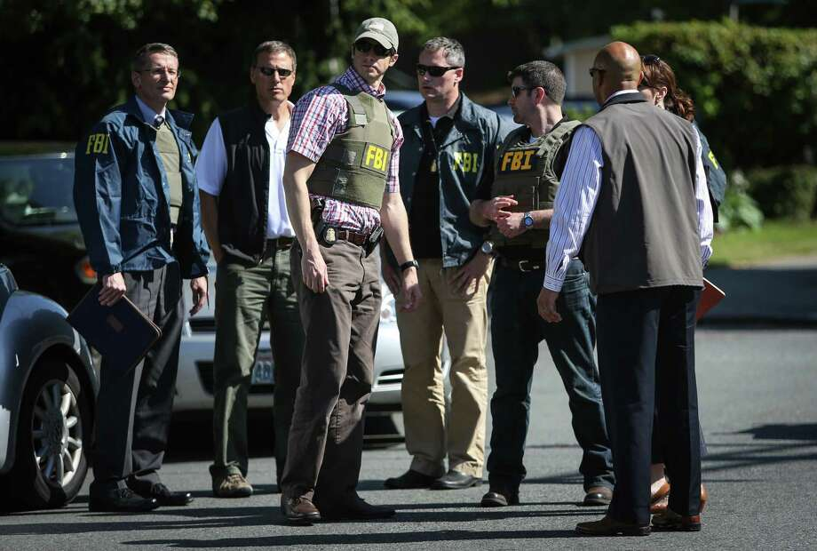 FBI officials arrive after a shooting at Seattle Pacific University on Thursday, June 5, 2014. A man that shot students was disarmed by others at the scene. Photo: JOSHUA TRUJILLO, SEATTLEPI.COM / SEATTLEPI.COM