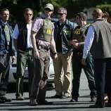 FBI officials arrive after a shooting at Seattle Pacific University on Thursday, June 5, 2014. A man that shot students was disarmed by others at the scene.