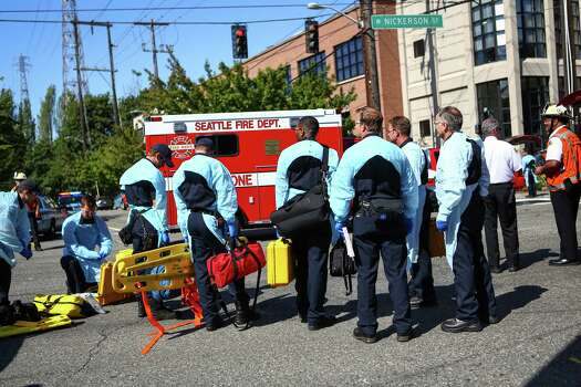 Medics wait to enter the scene after a shooting at Seattle Pacific University on Thursday, June 5, 2014. A man that shot students was disarmed by others at the scene. Photo: JOSHUA TRUJILLO, SEATTLEPI.COM / SEATTLEPI.COM